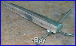 Older Craftsman 103. Table saw genuine parts cast iron fence with round rail